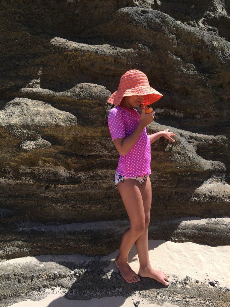 hawaii eternity beach girl wearing hat under the sun