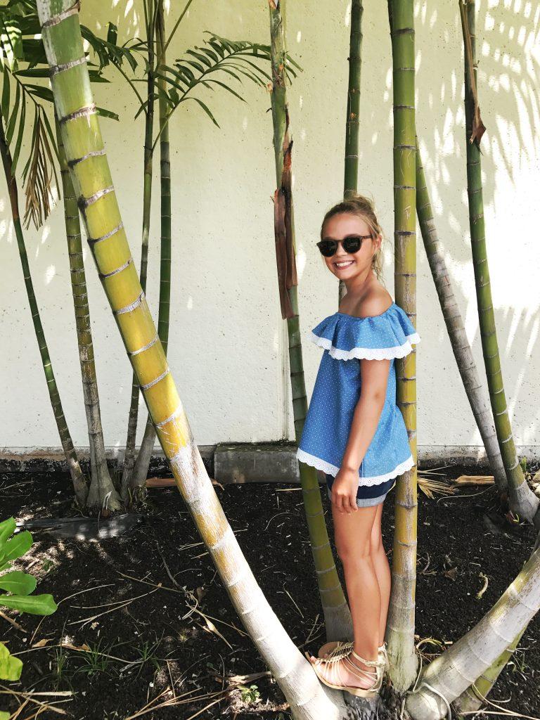 hawaii blues girl wearing blue shirt